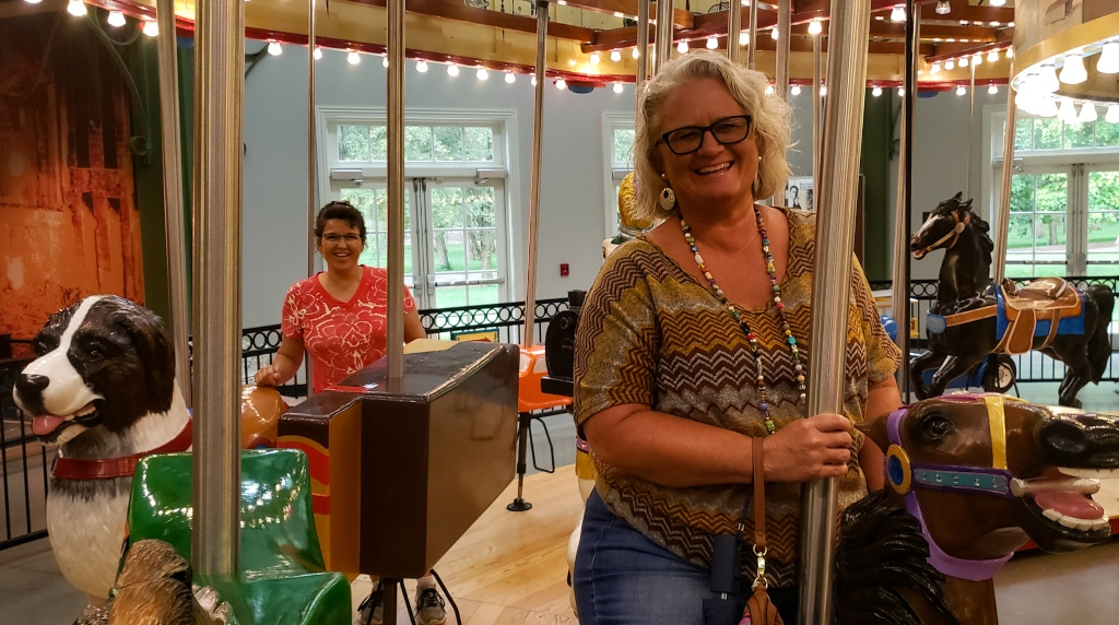 Riding the carousel in the Carillon Historical Park.