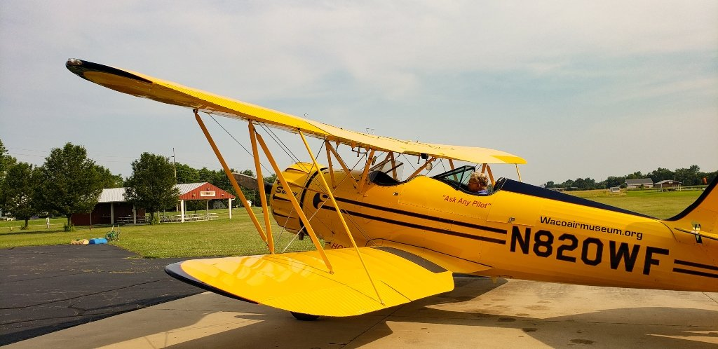 Sunny, a bright yellow bi-plane that gives rides at the WACO Air Museum near Dayton, Ohio.