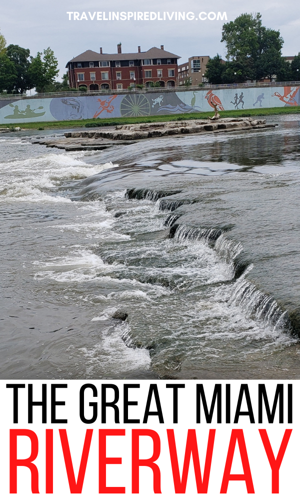 The Great Miami River as it's seen flowing through downtown Dayton with the 1,000 foot long River Run Mural in the background.