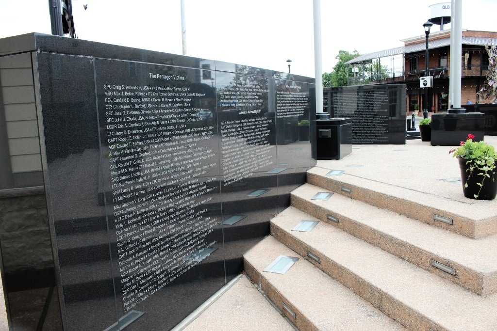 A black granite memorial wall lists the names of those who died on 9/11.