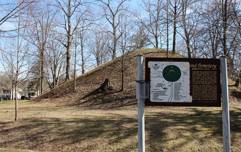 A cemetery with an Indian burial mound in the middle of it.