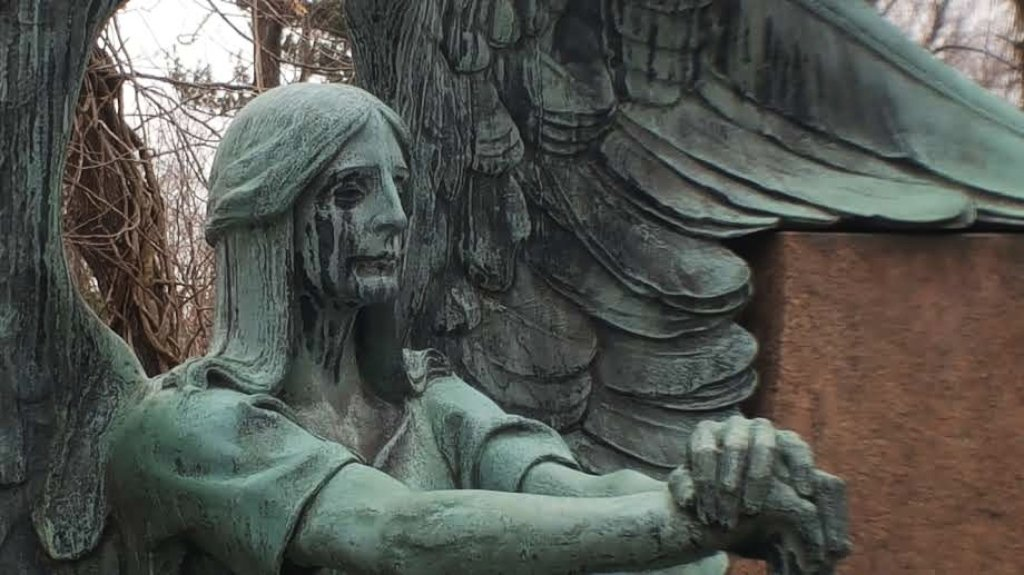 This grave memorial of an angel crying black tears is seen at the Lake View Cemetery in Cleveland.